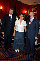 Left to right, French Government minister XAVIER DACROS, his wife and the French Ambassador to the UK HE GERARD ERRERA at the presentation of a Chevalier dans l'ordre de la LŽgion d'Honneur to chef Albert Roux held at Le Gavroche, 43 Upper Brook Street, London on 9th September 2005.<br /><br />NON EXCLUSIVE - WORLD RIGHTS