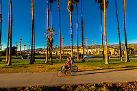 Bicycling along a path between Cabrillo Boulevard and East Beach, Santa Barbara, California USA.