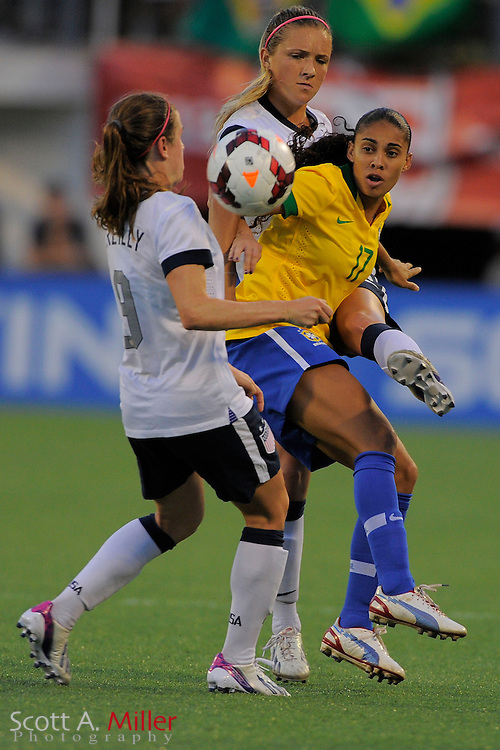 U.S. defender Kristie Mewis (8) and Brazil midfielder Nene (17) fight for a ball during the United States' 4-1 win over Brazil in an international friendly at the Florida Citrus Bowl on Nov. 10, 2013 in Orlando, Florida. <br /> <br /> &copy;2013 Scott A. Miller