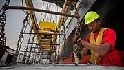 Worker unload a vessel of break bulk at at the Georgia Ports Authority Ocean Terminal, Wednesday, July, 19, 2017, in Savannah, Ga. (GPA Photo/Stephen B. Morton)