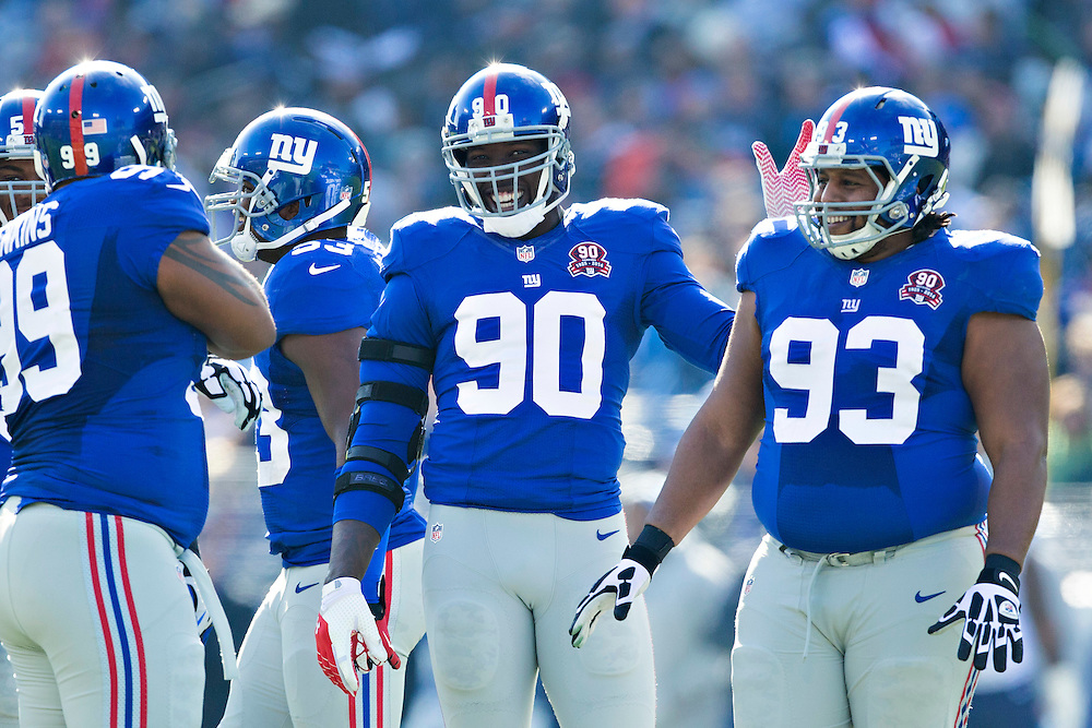 NASHVILLE, TN - DECEMBER 7:  Cullen Jenkins #99, Johnathan Hankins #95, Mike Patterson #93 and Jason Pierre-Paul #90 of the New York Giants joke around at the line of scrimmage in the first quarter of a game against the Tennessee Titans at LP Field on December 7, 2014 in Nashville, Tennessee.  The Giants defeated the Titans 36-7.  (Photo by Wesley Hitt/Getty Images) *** Local Caption *** Cullen Jenkins; Johnathan Hankins; Jason Pierre-Paul; Mike Patterson