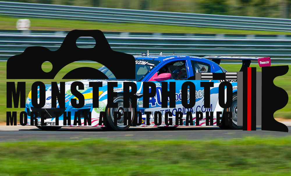 Dempsey &amp; Foster drivers of the No. 40 Mazda RX-8 speed down straight away during qualifying Friday, July 22, 2011, at New Jersey Motorsports Park in Millville New Jersey.<br />