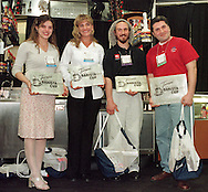 From left, Christina Gibbs, of Saginaw, Michigan, second runner-up, Andrea Dreschler, third runner-up, Max Gabriello, of Andover, Mass., Grand Champion, and Michael McGuire, of Homer, Alaska, first runner-up, pose for a photo after the Torani 5th Annual Barista Cup, Monday, May 3, 1999, in Philadelphia. Gabriello, declared best Barista in the USA, won a trip to Italy, and McGuire the runner up, won a Faema Espresso machine gift package. Gibbs, and Dreschler each won $100.00 cash. (Photo by William Thomas Cain)