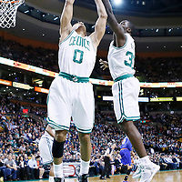 26 March 2013: Boston Celtics point guard Avery Bradley (0) grabs a rebound with Boston Celtics power forward Brandon Bass (30) during the New York Knicks 100-85 victory over the Boston Celtics at the TD Garden, Boston, Massachusetts, USA.