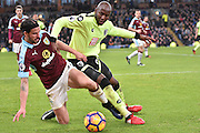 Bournemouth Forward, Benik Afobe (9) and Burnley Midfielder, George Boyd (21) during the Premier League match between Burnley and Bournemouth at Turf Moor, Burnley, England on 10 December 2016. Photo by Mark Pollitt.