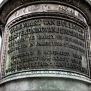 The inscription at the base of the statue of Godfrey of Bouillon, leader of the first crusade in 1096 AD, that stands in the center of the Place Royale in central Brusses, Belgium. The statue was sculpted by Eugene Simonis in 1848. The statue stands in front of the Church of Saint Jacques-sur-Coudenberg.