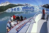Visitors get up close and personal with a glacier in Prince William Sound from on board a mid size catamaran.