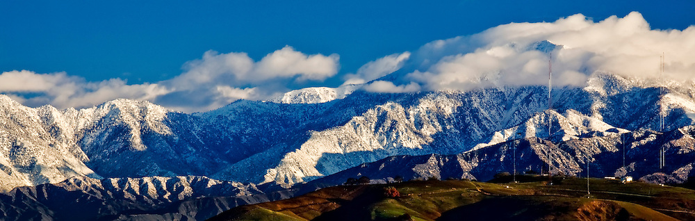 Snow capped San Gabriel mountains as seen from Bastanchury Summit in Fullerton, California. The foothills of Brea can be seen in the foreground.