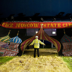 London, UK - 3 November 2013: the circus scenic is dismantled on the last last night of the show in Ealing Common.