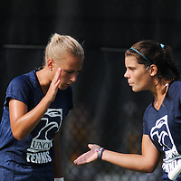 UNCW's Annika Sillanpaa, left, and Christine Kharkevich celebrate a return against Virginia Tech Saturday September 13, 2014 at UNCW. (Jason A. Frizzelle)