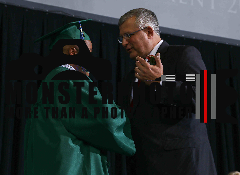 Thomas McKean High School graduate KeeRon Garnett Lamotte Bell receives his diploma during McKean 49th commencement exercises Saturday, June 06, 2015, at The Bob Carpenter Sports Convocation Center in Newark, Delaware.