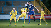 Will Hatfield (Guiseley) and Kingsley James (Halifax) jump for the ball during the Conference Premier League match between FC Halifax Town and Guiseley at the Shay, Halifax, United Kingdom on 5 December 2015. Photo by Mark P Doherty.