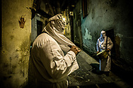 At tre oclock in the morning of the Friday before easter the official religous procession starts, two hooded men annouces the start with a drum and a trumpet. Verbicaro, Italy. April 18th, 2014. Federico Scoppa