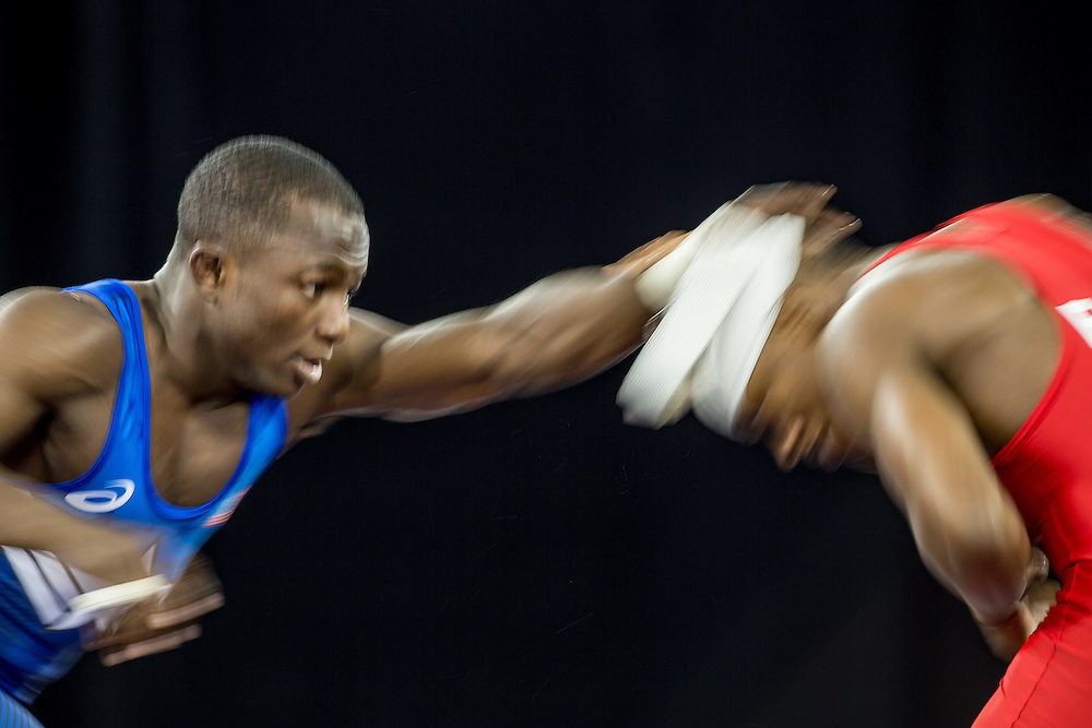 Spenser Mango (L) of the United States dislodges the bandage of Andres Montano of Ecuador during their semi-final bout in the 59kg class of the men's greco-roman wrestling  at the 2015 Pan American Games in Toronto, Canada, July 15,  2015.  AFP PHOTO/GEOFF ROBINS