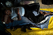 State police sleep in their base in the town of Leheri in the state of Maharashtra in India October 13, 2009.  Police in the area have suspended patrols in the area after a violent Maoist rebel ambush killed 17 officers on patrol. The Indian government has begun to increase it's presence of police and military in Naxal dominated states such as Maharastra and Chhattisgarth in response to recent levels of violence by Naxals including an incident where an ambush killed 17 state police.