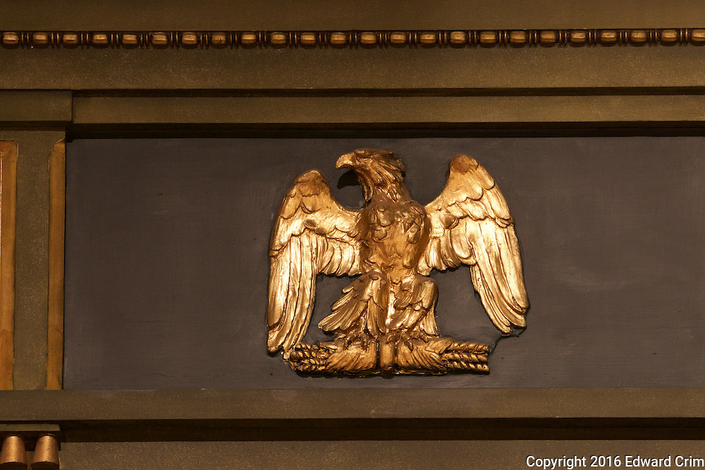 An eagle clutching what just could be some ill-formed arrows, or more likely sheaves  of wheat, decorates the north wall of the Senate chamber of the Pennsylvania capitol in Harrisburg.