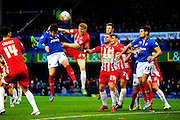 Portsmouth's Marc McNulty heads the ball towards goal under the challenge of Accrington Stanley's Bradley Halliday during the The FA Cup match between Portsmouth and Accrington Stanley at Fratton Park, Portsmouth, England on 5 December 2015. Photo by Graham Hunt.