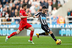 Remy Cabella of Newcastle United tries to tap in a shot as Alberto Moreno of Liverpool challenges but his effort goes wide - Photo mandatory by-line: Rogan Thomson/JMP - 07966 386802 -01/11/2014 - SPORT - FOOTBALL - Newcastle, England - St James' Park - Newcastle United v Liverpool - Barclays Premier League.