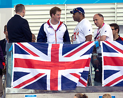 Prince Harry with ARMY AMPUTEE DEREK DERENALAGI and  Team GB Members at the Aquatics Centre at the London 2012 Paralympics Games, Tuesday September 2012. Photo By i-Images