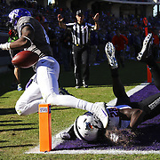 TCU's Jeff Gladney, left, and OSU's James Washington dive after an incomplete pass during a college football game between Oklahoma State and TCU at Amon G. Carter Stadium in Fort Worth, Texas, Saturday, November 19 2016. Kurt Steiss/O'Colly