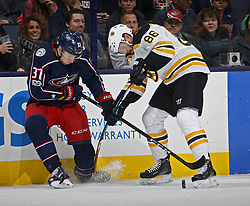 October 30, 2017 - Columbus, OH, USA - Columbus Blue Jackets left wing Markus Hannikainen (37) and Boston Bruins defenseman Kevan Miller (86) battle for the puck during the 1st period of their NHL game at Nationwide Arena in Columbus, Ohio on Oct. 30, 2017. (Credit Image: © Kyle Robertson/TNS via ZUMA Wire)