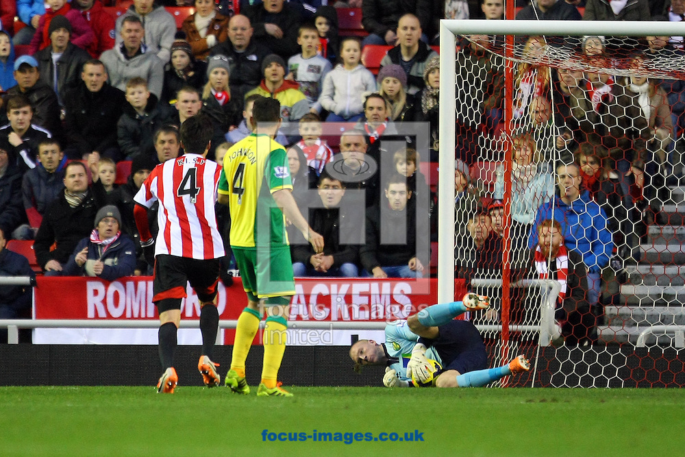Picture by Paul Chesterton/Focus Images Ltd +44 7904 640267<br /> 21/12/2013<br /> John Ruddy of Norwich saves a shot from Sunderland's Ki Sung-Yueng during the Barclays Premier League match at the Stadium Of Light, Sunderland.