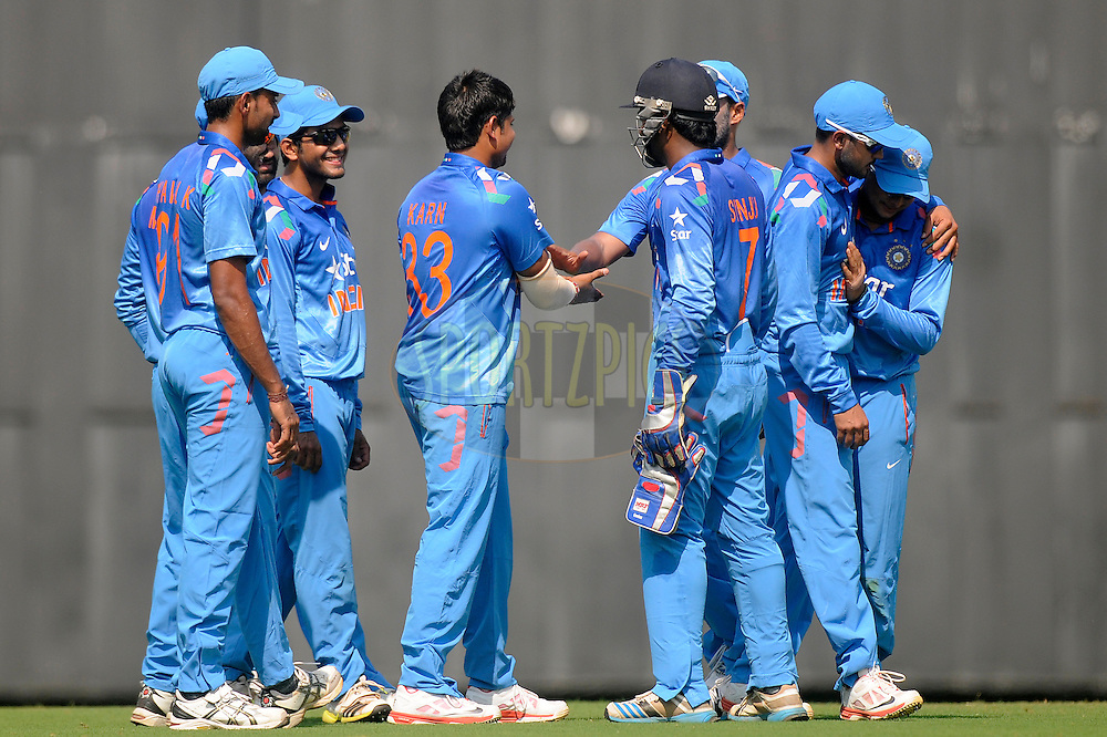 Karan Sharma of India A celebrates the wicket of  Tillakaratne Dilshan of Sri Lanka during the practice match between India A and Sri Lanka held at the CCI Stadium, Mumbai,  India on the 30th October 2014<br /> <br /> Photo by:  Pal Pillai/ Sportzpics/ BCCI