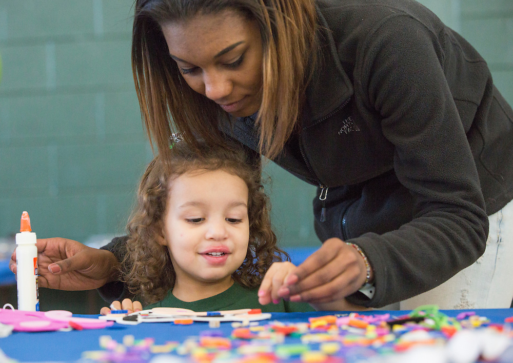 Ohio University sophomore Gabby King makes a mask with her sister Lyla King, 3, of Columbus, Ohio, at the crafts station at the Sibs Bash in Walter Fieldhouse during Sibs weekend on February 6, 2016. Photo by Emily Matthews