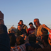 Residents fleeing Mosul wait to receive aid at a camp for Internally Displaced People inKalak, Iraq.