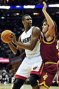 Dec. 2, 2010; Cleveland, OH, USA;  Miami Heat power forward Chris Bosh (1) drives into Cleveland Cavaliers power forward Anderson Varejao (17) during the first quarter of the game at Quicken Loans Arena. Mandatory Credit: Jason Miller-US PRESSWIRE
