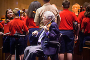 14 FEBRUARY 2012 - PHOENIX, AZ:   Classical violinist ITZHAK PERLMAN (center seated) plays in the Arizona State Senate Tuesday. Perlman performed the Star Spangled Banner with the Southwest Stringers, a violin orchestra of elementary school students from Mesa, AZ. After preforming Perlman asked legislators to continue supporting education in the arts.     PHOTO BY JACK KURTZ
