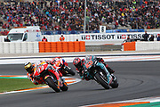 #93 Marc Marquez, Spanish: Repsol Honda Team takes the lead from #20 Fabio Quatararo, French: Petronas Yamaha SRT during the Gran Premio Motul de la Comunitat Valenciana at Circuito Ricardo Tormo Cheste, Valencia, Spain on 17 November 2019.