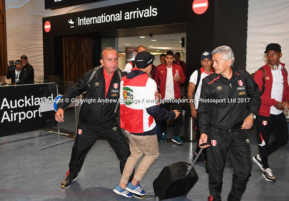 A young Peru football fan is stopped in his tracks by security at Auckland Airport as he celebrates the arrival of their team ahead of the first leg of Intercontinal playoff against the New Zealand All Whites for the 2018 FIFA World Cup in Russia. Auckland, New Zealand. Tuesday 7 November 2017. © Copyright photo: Andrew Cornaga / www.photosport.nz