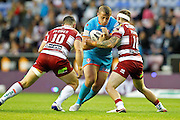 Greg Richards runs into a Wigan brick wall of Ben Flower and Sam Powell during the Super 8's Round 3  match between Wigan Warriors and St Helens at the DW Stadium, Wigan, England on 19 August 2016. Photo by Craig Galloway.