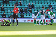 Olivier Ntcham and Lewis Stevenson lie injured after clashing during the Ladbrokes Scottish Premiership match between Hibernian and Celtic at Easter Road, Edinburgh, Scotland on 16 December 2018.