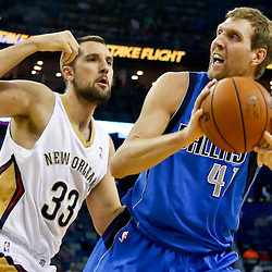 Dec 4, 2013; New Orleans, LA, USA; Dallas Mavericks power forward Dirk Nowitzki (41) is guarded by New Orleans Pelicans power forward Ryan Anderson (33) during the first quarter of a game at New Orleans Arena. Mandatory Credit: Derick E. Hingle-USA TODAY Sports