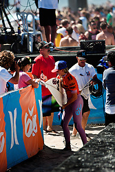HUNTINGTON BEACH, California/USA (Saturday,Aug 6, 2011)  Lakey Peterson signs an autograph for a fan moments  after defeating finals leader  Malia Manuel to  win the Hurley US Open of Surfing PRO Junior.  Photo: Eduardo E. Silva.