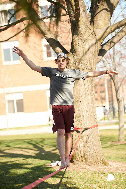 Activity; Socializing; Playing; Buildings; Eagle Hall; Location; Outside; People; Student Students; Spring; April; Time/Weather; sunny; Type of Photography; Candid; UWL UW-L UW-La Crosse University of Wisconsin-La Crosse; Man Men