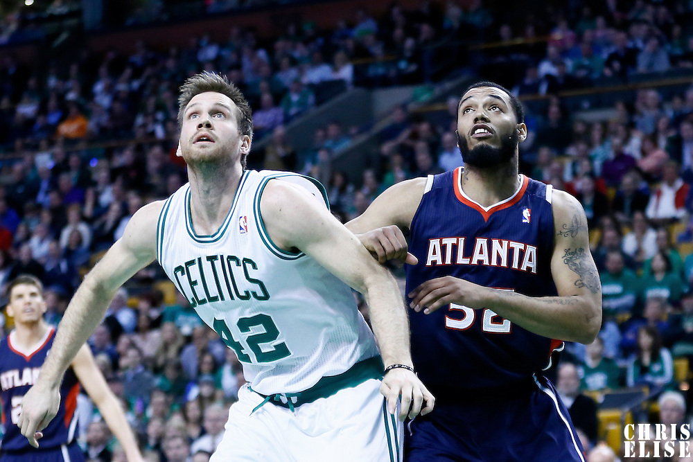 29 March 2013: Boston Celtics power forward Shavlik Randolph (42) vies for the rebound with Atlanta Hawks power forward Mike Scott (32) during the Boston Celtics 118-107 victory over the Atlanta Hawks at the TD Garden, Boston, Massachusetts, USA.