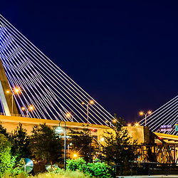 Boston Panorama photo of Zakim Bunker Hill Bridge at night. The Leonard P. Zakim Bunker Hill Memorial Bridge is a cable bridge that spans the Charles River in Boston, Massachusetts in the Eastern United States or America. Copyright ⓒ Paul Velgos with All Rights Reserved.