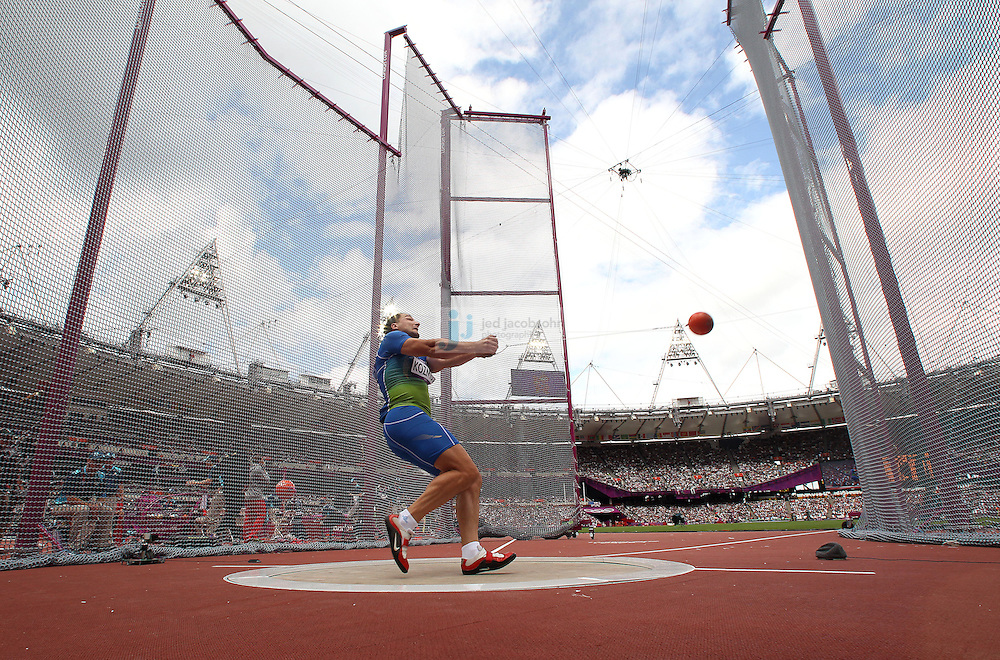 Primoz Kozmus of Slovenia throws during the men' s hammer throw qualification round during the track and field event at the Olympic Stadium during day 6 of the London Olympic Games in London, England, United Kingdom on August 3, 2012..(Jed Jacobsohn/for The New York Times)..