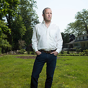 Port Chester, NY : Kevin Barrett, a lawyer working for the Attorney General of West Virginia, poses for a portrait in the backyard of his Port Chester, New York home on Wednesday morning. Barrett and the West Virginia AG are working on the bankruptcy of Alpha Natural Resources, which bought the coal company Massey Energy. CREDIT: Karsten Moran for The New York Times
