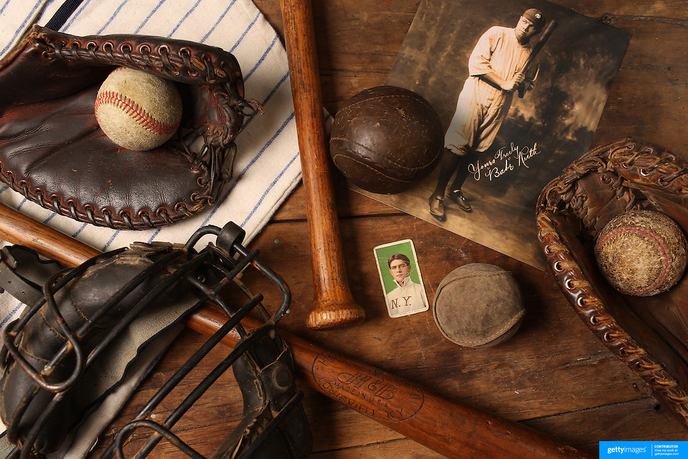 A collage of Antique Vintage Baseball Memorabilia and Collectables including baseballs, wooden baseball bats, hat, catchers mask, baseball card, signed photograph and baseball shirt. 7th June 2012. Photo Tim Clayton