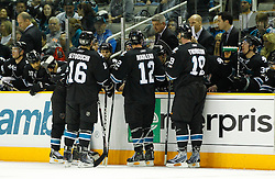 April 14, 2011; San Jose, CA, USA; San Jose Sharks head coach Todd McLellan (top) speaks to his team during the third period against the Los Angeles Kings at HP Pavilion. Mandatory Credit: Jason O. Watson / US PRESSWIRE