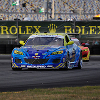 Team Dempsey Racing competing at the Rolex 24 at Daytona 2012