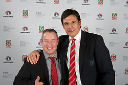 CARDIFF, WALES - Monday, October 5, 2015: Wales' manager Chris Coleman with photographer Ian Cook during the FAW Awards Dinner at Cardiff City Hall. (Pic by Ian Cook/Propaganda)