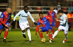 March 21, 2018 - Dagenham, England, United Kingdom - L-R West Ham United's Arthur Masuaku, Dagenham & Redbridge's Chike Kandi and West Ham United's Alfie Lewis.during Friendly match between Dagenham and Redbridge against West Ham United at Chigwell Construction  stadium, Dagenham England on 21 March 2018. (Credit Image: © Kieran Galvin/NurPhoto via ZUMA Press)