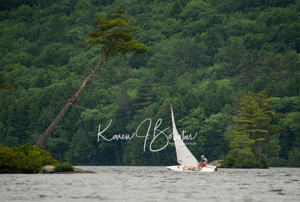 A lone sailor enjoying good wind on Lake Wicwas Monday afternoon.  (Karen Bobotas/for the Laconia Daily Sun)