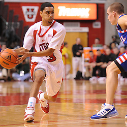 Jan 31, 2009; Piscataway, NJ, USA; Rutgers guard Mike Rosario (3) passes into the paint to teammate forward Gregory Echenique (00) during the first half of Rutgers' 75-56 victory over DePaul in NCAA college basketball at the Louis Brown Athletic Center