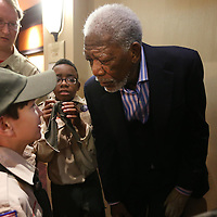 Adam Robison | BUY AT PHOTOS.DJOURNAL.COM<br /> Morgan Freeman talks with Boy Scout Conner Graham, 12, before the start of the Boy Scouts of America Yocona Area Council Distinguished Citizen Banquet at the BancorpSouth Conference Center Friday night in Tupelo. Freeman is the Yocona Area Councils's Distiguished Citizen Award Winner.